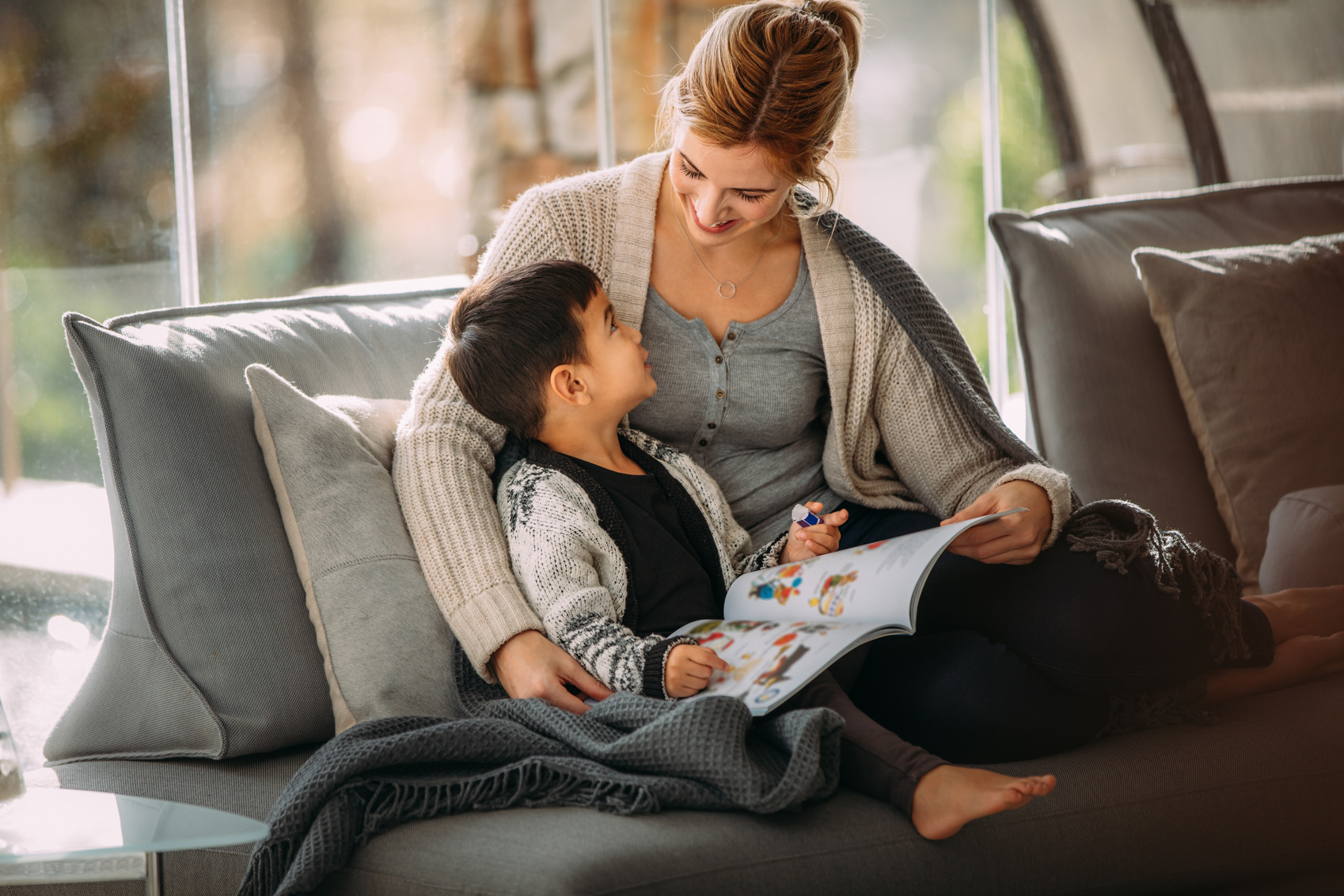 A parent showing their child a book, showing the true goal of Storyline Online.